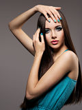 Beautiul elegant woman with turquoise make-up and nails. Straigh Stock Photos