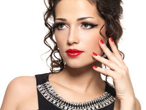 Beautiul fashion woman with red manicure and lips royalty free stock photos