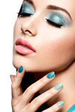 Beautiul fashion woman with turquoise make-up and nails Royalty Free Stock Photo