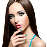 Beautiul fashion woman with turquoise make-up and nails. On white background Stock Photo