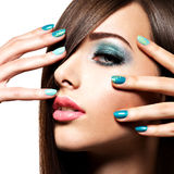 Beautiul fashion woman with turquoise make-up and nails. On white background Royalty Free Stock Photo