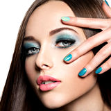 Beautiul fashion woman with turquoise make-up and nails. On white background Stock Image