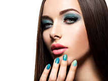 Beautiul fashion woman with turquoise make-up and nails. On white background Stock Photography