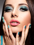 Beautiul fashion young adult girl with turquoise make-up and nai Royalty Free Stock Photography