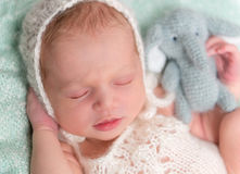 Beautiul sleeping baby in hat closeup Stock Photos