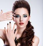 Beautiul woman with green make-up. creative color of nails. Beautiul woman with green make-up and creative color of nails Stock Photography