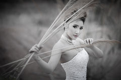 Beautuful bride in forest,cloudy twilight blue sky Stock Photo