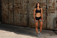 Beautuful hispanic woman workout with dumbbells studio portrait.  royalty free stock image