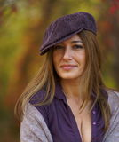 Beautuful woman in a cap. And purple hues in clothes Royalty Free Stock Image