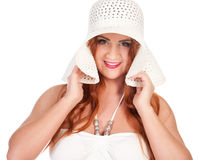 Beautuful woman with red long hair posing in white dress and hat Royalty Free Stock Photos