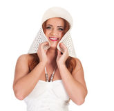 Beautuful woman with red long hair posing in white dress and hat Royalty Free Stock Images