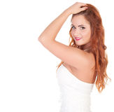 Beautuful woman with red long hair posing in white dress Royalty Free Stock Photography