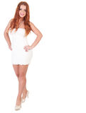 Beautuful woman with red long hair posing in white dress Stock Images
