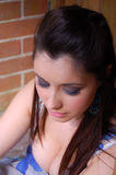 Beauty!. A beautiful lady sitting on the door step, waiting stock photography