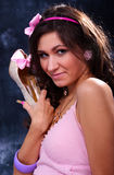 Beauty. Beautiful woman in a pink dress holds a shoe in a hand Stock Photos