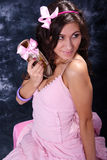Beauty. Beautiful woman in a pink dress holds a shoe in a hand Stock Photo