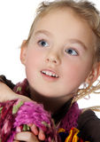 Beauty. Portrait of a pretty little girl posing, looking on the sky and smiling Royalty Free Stock Images