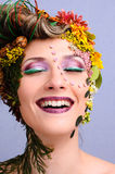 Beauty. Beautiful girl laughing with art make up Stock Images