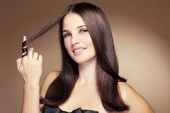 Beauty. Portrait of young beautiful woman with long glossy hair Stock Images