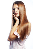 Beauty. Portrait of young beautiful woman with long glossy hair Royalty Free Stock Image