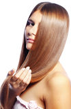 Beauty. Portrait of young beautiful woman with long glossy hair Royalty Free Stock Photos
