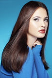Beauty. Portrait of young beautiful woman with long glossy hair Royalty Free Stock Photography