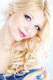 Beauty. Portrait of young beautiful blond woman with fashion make-up and hairstyle Stock Images