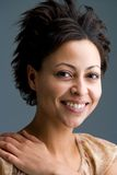 Beauty. Happily smiling mulatto woman looking into the camera Royalty Free Stock Photos