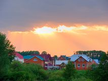 Beauty. The small settlement is shined with evening beams of the summer sun Stock Photography
