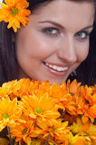 Beauty. Happy woman with orange flower stock image
