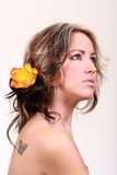 Beauty. Pretty blond women with flowers in her hair looking away royalty free stock photography