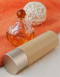Beauty accessories. Body lotion with parfum on the terracotta towel Stock Photo