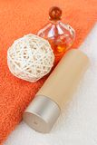Beauty accessories. Body lotion with parfum on the terracotta towel Stock Image