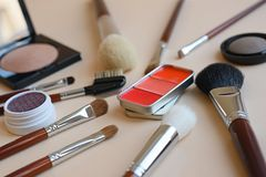 Beauty accessories. makeup brushes, eye shadow, compact powder, blush in metal box royalty free stock photos