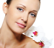Beauty adult female face with flowers Stock Photo