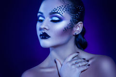 Beauty adult girl in cold tones with elegance make up Royalty Free Stock Photo