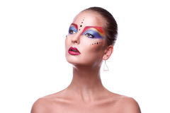 Beauty adult girl with multicolor make up looking away Royalty Free Stock Photography