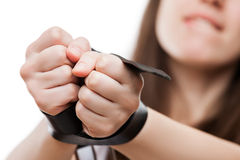 Beauty adult passionate woman with leather belt strap tied hands Stock Image