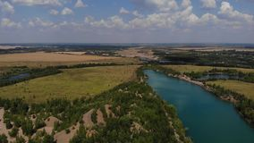 Beauty aerial footage of hills and cristal blue lake. Nice footage of old career with nice lakes.  stock footage