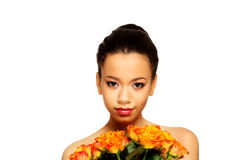 Beauty african woman with roses. royalty free stock photo