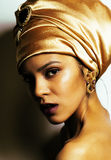 Beauty african woman in shawl on head, very elegant look with go. Ld jewelry close up Stock Image