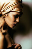 Beauty african woman in shawl on head, very elegant look with go. Ld jewelry close up mulatto makeup macro Stock Photos