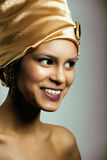 Beauty african woman in shawl on head, very elegant look with gold jewelry. Close up Royalty Free Stock Photography