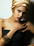 Beauty african woman in shawl on head, very elegant look with gold jewelry Stock Image