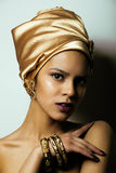 Beauty african woman in shawl on head, very. Elegant look with gold jewelry close up Stock Photo