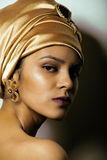 Beauty african woman in shawl on head, very. Elegant look with gold jewelry close up mulatto Stock Image