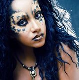 Beauty afro girl with cat make up, creative leopard print. Closeup stock photography