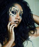 Beauty afro girl with cat make up, creative leopard print closeu. P halloween royalty free stock image