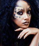 Beauty afro girl with cat make up, creative leopard print closeu. P halloween stock photo