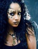 Beauty afro girl with cat make up, creative leopard print closeu. P halloween stock photography